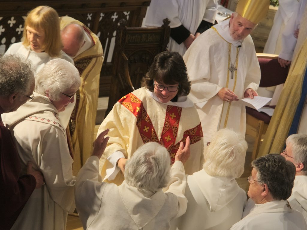 Priests from around the diocese greet newly ordained Nerys