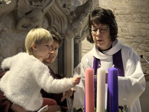 Zoe lit the first candle in our Advent wreath, the candle of hope.